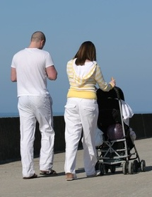 Exercise after pregnancy, mum, dad and baby walking
